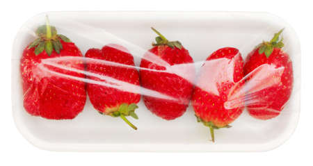 strawberry in vacuum packing isolated on white background with clipping path