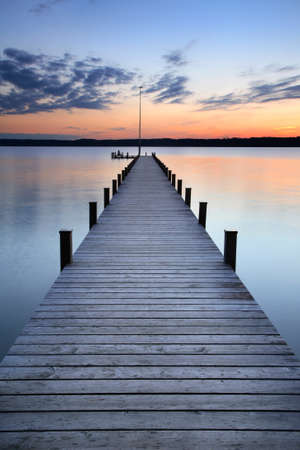 Photo for Lake at Sunset, Long Wooden Pier - Royalty Free Image