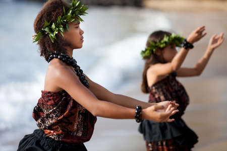 Photo for Pretty Hula Girl dancing at the beach wearing a handmade head piece - Royalty Free Image