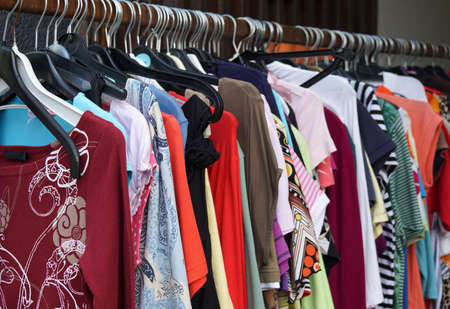 Photo for 2nd hand sale clothes rack with a selection of fashion for women - Royalty Free Image