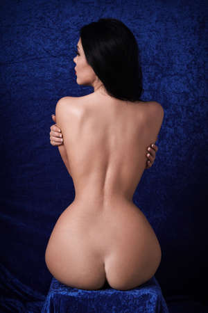 Photo for rear view of naked woman with hourglass figure, slim waist and womanly hips - Royalty Free Image