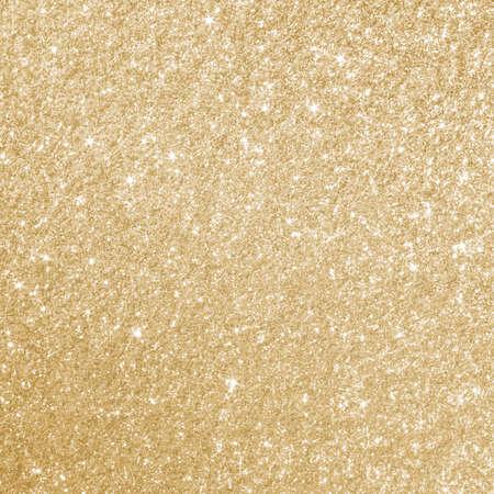 Foto de Glittery gold background texture perfect for Luxury, fashion or Christmas and holiday season designs. - Imagen libre de derechos