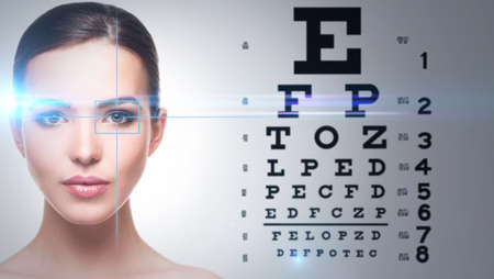 Photo for Beautiful woman and eye chart on background - Royalty Free Image