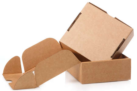 Foto de Small cardboard boxes on white background - Imagen libre de derechos
