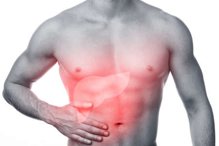 Foto de Problems with liver. Man feels pain and holding hand on his stomach. Isolated on white. - Imagen libre de derechos