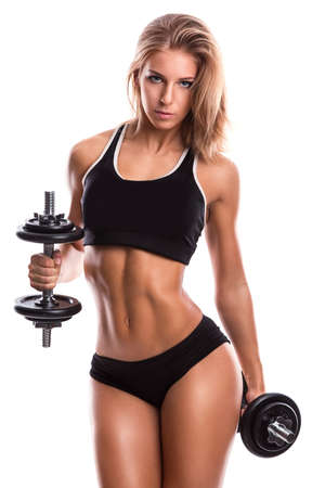 Foto de Beautiful and sexy fitness girl with dumbbells - Imagen libre de derechos