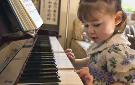 Girl playing on the piano