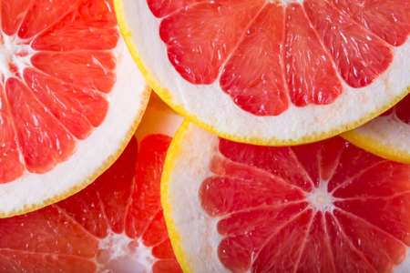 Photo for background made with a heap of sliced grapefruits - Royalty Free Image
