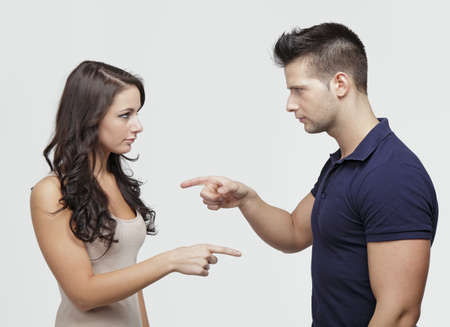 Couple pointing to each other