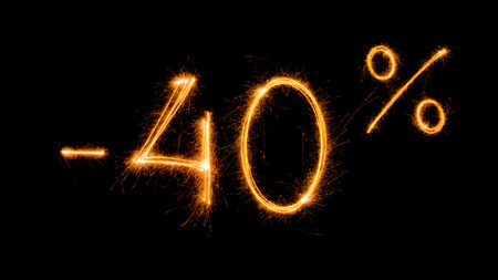 Photo pour Sale 40 procent off - made with sparklers on black background. - image libre de droit