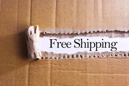 Photo for Torn paper box with word Free shipping - Royalty Free Image