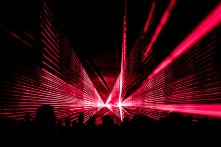 Foto per Red laser show nightlife club stage with party people crowd. - Immagine Royalty Free