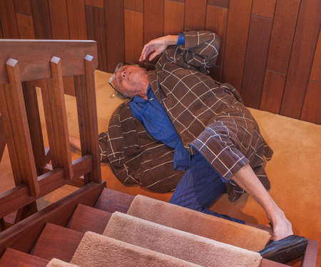 Photo for Senior man just fell down the stairs - Royalty Free Image