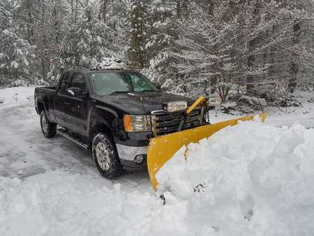 Photo for Truck snow plow clearing a parking lot after storm - Royalty Free Image