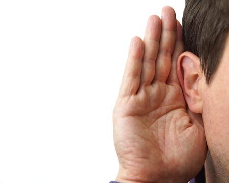Foto de Businessman holds his hand near his ear and listening - Imagen libre de derechos