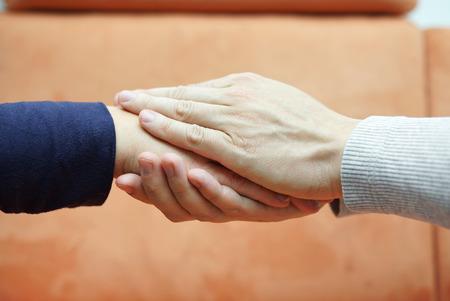 Foto de man hands holding  woman hand from both sides  Compassion and concern concept - Imagen libre de derechos