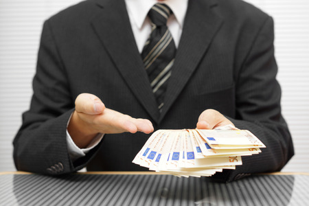 Photo pour businessman shows that you take money and accept the deal. financial fraud and precaution concept - image libre de droit