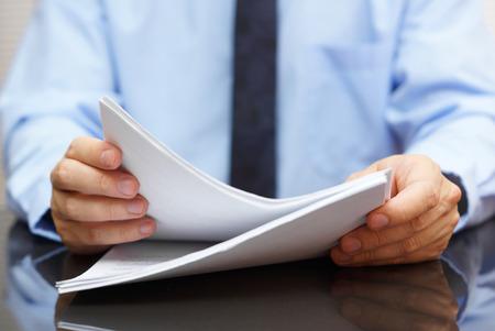 Photo for auditor is reading documentation - Royalty Free Image