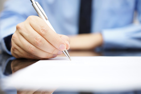 Photo for Business man signing the contract to finalize a deal - Royalty Free Image