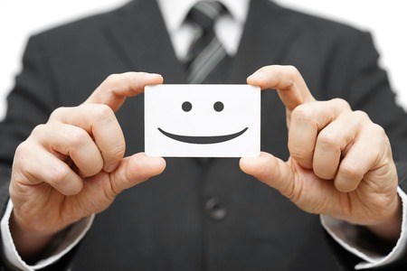 Photo for our clients are happy clients, smile on business card - Royalty Free Image