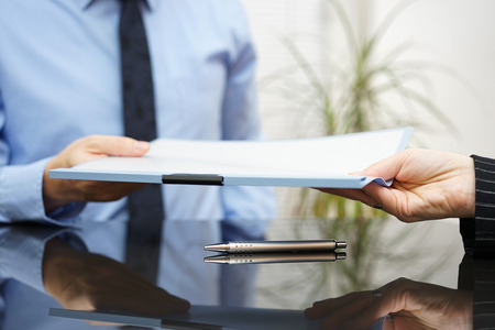 Foto de businessman is passing signed agreement to client after successful negotiation - Imagen libre de derechos