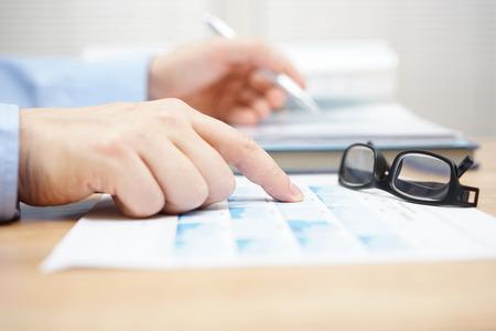 Photo pour financial consultant is reviewing investment portfolio - image libre de droit