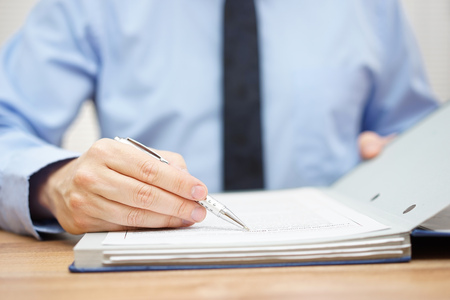 Photo for auditor is examining articles of agreement - Royalty Free Image