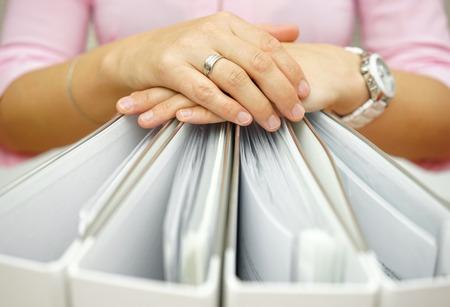 Foto de Secretary holding binders, concept of accounting,business,documentation,paperwork - Imagen libre de derechos
