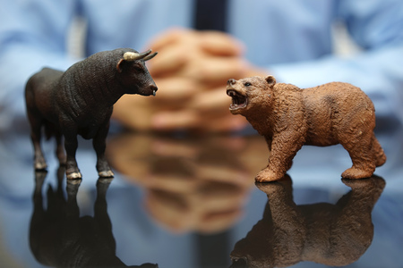 Photo pour businessman is watching bull and bear , concept of stock market and investing - image libre de droit