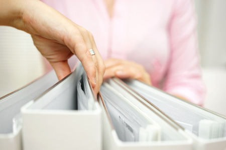Photo for businesswoman is inspecting documentation - Royalty Free Image