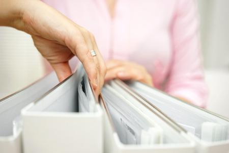Foto de businesswoman is inspecting documentation - Imagen libre de derechos