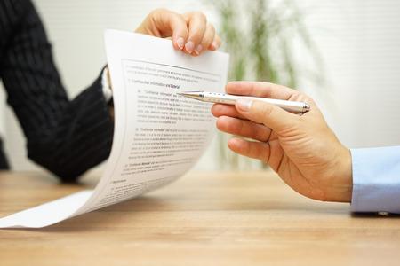 Photo pour businesswoman holding legal document and  wants an explaination about article in contract - image libre de droit