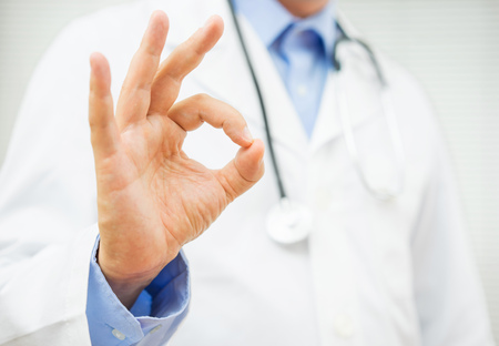 Photo for doctor showing ok sign, concept of healty man or trusting a doctor - Royalty Free Image