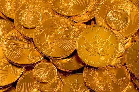 Photo for Canada Maple Leaf one ounce gold coin against a golden background of other coins with focus on the leaf - Royalty Free Image