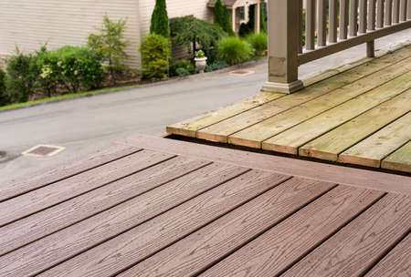 Photo pour Repair and replacement of an old wooden deck or patio with modern composite plastic material - image libre de droit