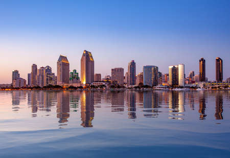 Photo pour Sunset illuminating the tall skyscrapers of San Diego in California from Centennial Park in Coronado with artificial water reflection - image libre de droit
