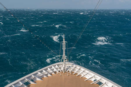 Photo pour View from front at the rough seas and waves forward of bow of cruise ship - image libre de droit