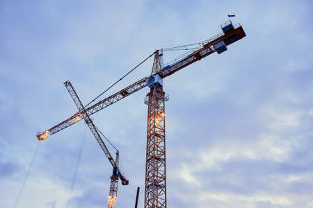 Photo for Construction cranes against the dark sky background - Royalty Free Image
