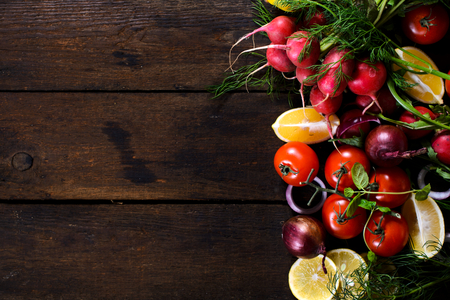 Large group of vegetables and fruit on the wooden background with blank space