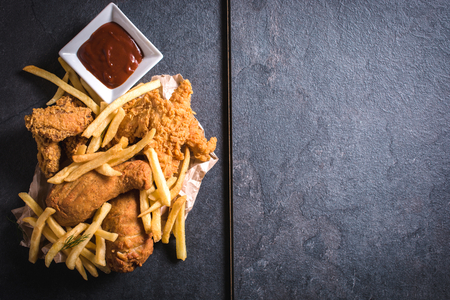 Photo for Fried chicken meat and French fries from above,blank space on the right side - Royalty Free Image