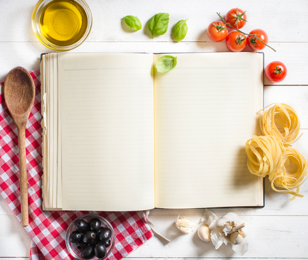 Photo for Blank recipe cooking book and ingredients on white table,selective focus and above - Royalty Free Image