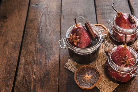 Photo for Sweet cooked pears and red wine served in the jars,selective focus and blank space - Royalty Free Image
