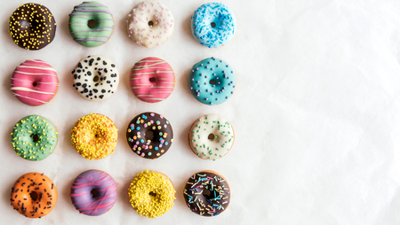 Photo for Variety of sweet homemade donuts with blank space - Royalty Free Image