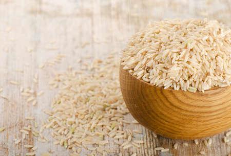 Photo pour brown rice on a wooden table. Selective focus - image libre de droit