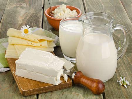 Photo pour Fresh milk and dairy products on a wooden table. Selective focus - image libre de droit