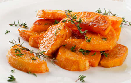 Photo for Baked sweet potato wedges on  white plate. Selective focus - Royalty Free Image