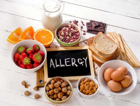 Foto de Food allergy. Allergic food on  wooden background. View from above - Imagen libre de derechos