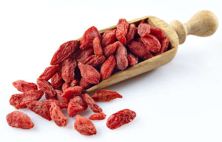 Photo for Wooden scoop of dried goji berries - Royalty Free Image