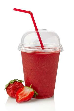 Foto de Glass of strawberry smoothie on white background - Imagen libre de derechos