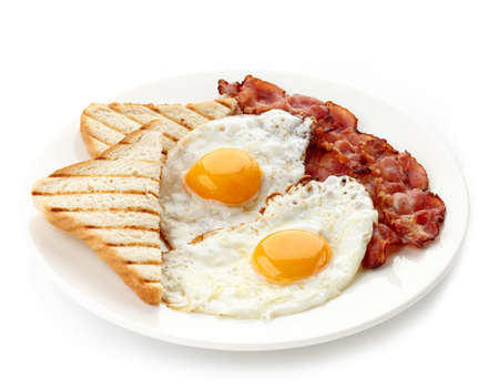 Photo for Plate of breakfast with fried eggs, bacon and toasts isolated on white  - Royalty Free Image